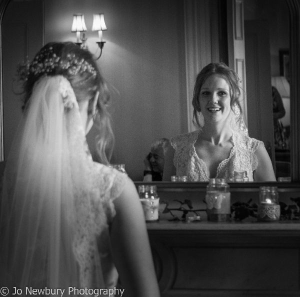 Jo Newbury Photography wedding image of bride looking in mirror.